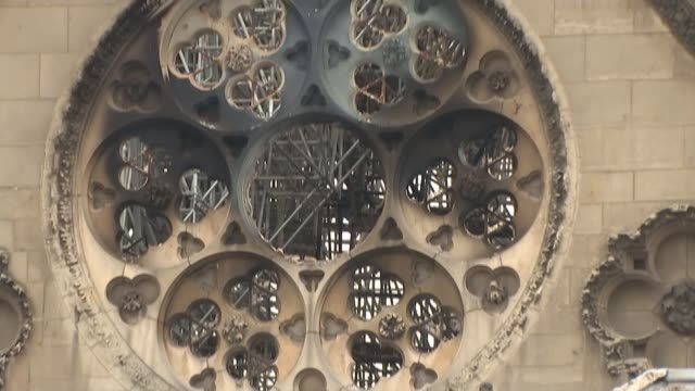 hundreds of millions pledged to rebuild cathedral france paris notredame cathedral ext blackened wall of firedamaged notre dame cathedral - rebuilding stock videos & royalty-free footage