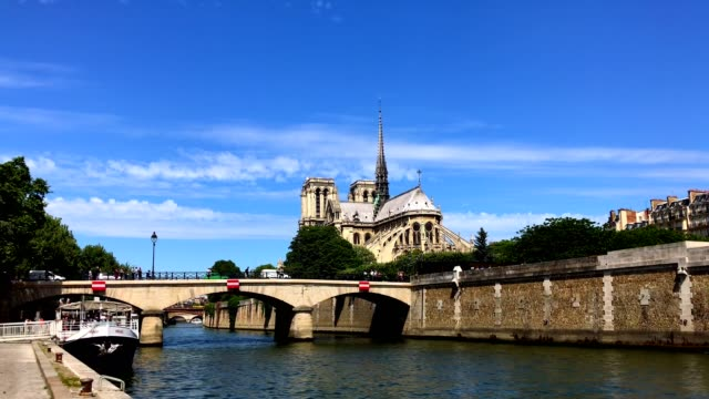 notredame de paris and seine river in paris france - cathedral stock videos & royalty-free footage
