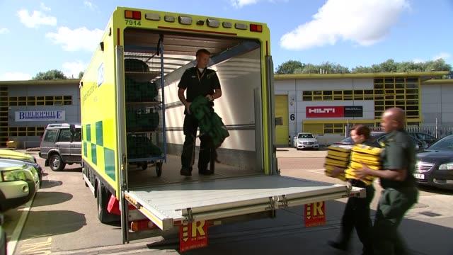 Preparations Newham London Ambulance Service worker preparing medical equipment Medics preparing medical supplies London Ambulance Service workers...