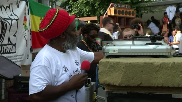 notting hill carnival 2017: silence observed for victims of grenfell tower fire; notting hill carnival: mikey dread puts on record - called 'grenfell... - レゲエ点の映像素材/bロール