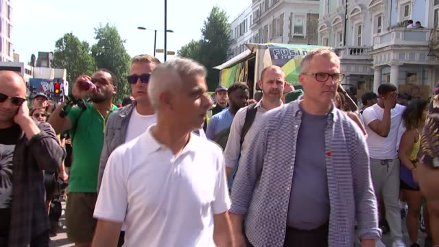 sadiq khan attends minute's silence for grenfell victims england london notting hill ext various of sadiq khan along through carnival crowds and... - notting hill videos stock videos & royalty-free footage