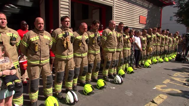 sadiq khan attends minute's silence for grenfell victims england london notting hill sadiq khan firefighters and members of public stand for minute's... - notting hill videos stock videos & royalty-free footage