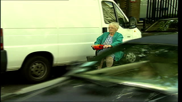40th plans unveiled itn england london ext woman along on electric scooter pan councillor merrick cockell interview sot we are taking any elderly... - butlins stock videos and b-roll footage
