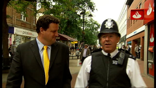 Notting Hill Carnival dancing policeman is internet sensation ITN Reporter along with Lawrence as interviewed SOT Close shot of Lawrence's feet TILT...