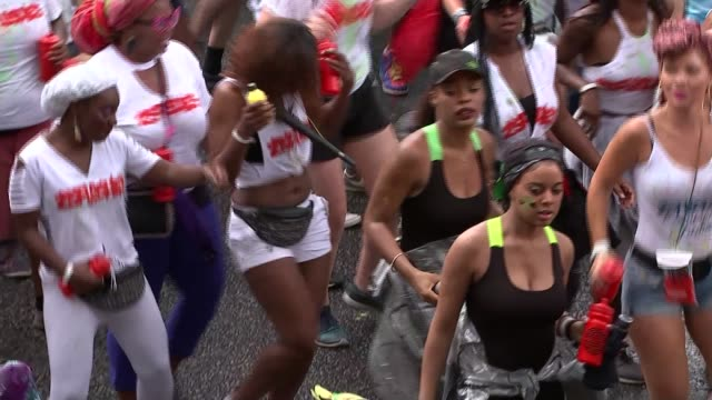 london notting hill ext general view people dancing in street carnival goer wearing giant football costume young person in carnival costume with... - stilts stock videos and b-roll footage
