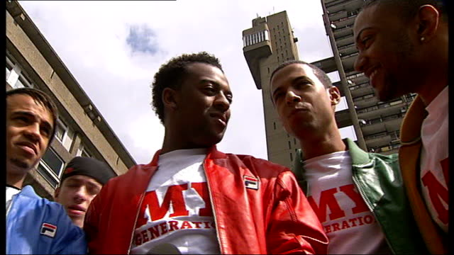 EXT General views Trellick Tower Members of JLS boyband interviewed SOT Nerves Reporter to camera Screaming fans surrounding JLS as arrive for...