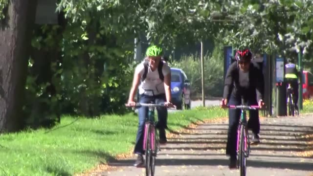nottingham cycle path gvs; england: nottinghamshire: nottingham: ext cyclists riding bikes and people walking and jogging along separated cycleway - jogging stock videos & royalty-free footage