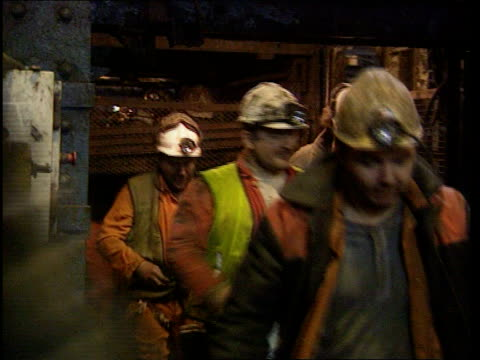 lib nottinghamshire clipstone colliery seq miners out of cage at end of shift along into showers and handing in equipment - nottinghamshire stock videos & royalty-free footage