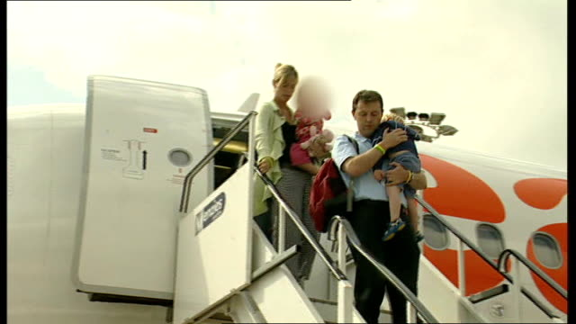 Nottinghamshire East Midlands Airport Kate McCann and Gerry McCann departing plane