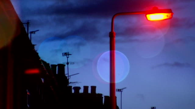 nottinghamshire police criticised for 'rape poem' ext / night general view of residential street street light high angle shot of houses with lights... - soft focus stock videos & royalty-free footage