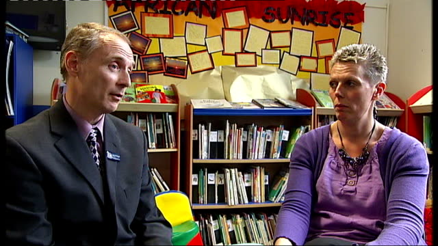 nottinghamshire: rob mcdonough and louise regan into classroom, shake hands and sit down to watch video monitor showing michael gove mp interview sot... - soft focus stock videos & royalty-free footage