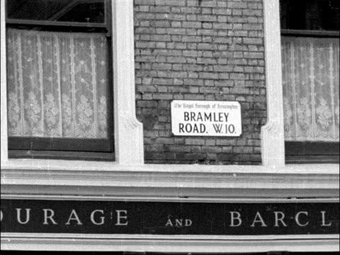nottingnhill racial disturbances england london notting hill gv street cu street sign 'bramley road' – pub below ms people in street –... - 1958 bildbanksvideor och videomaterial från bakom kulisserna