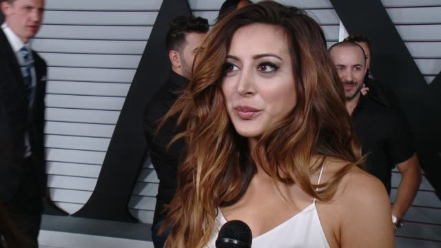 interview noureen dewulf on her dress and on being part of the hot 100 list at the maxim hot 100 and relaunch party at pacific design center on june... - pacific design center stock videos and b-roll footage