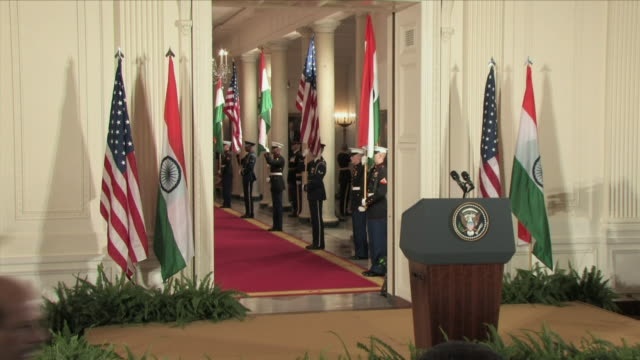 nov 2009 president barrack obama and indian prime minister manmohan singh walking down red carpet into east room / white house, washington d.c., usa... - lectern stock videos & royalty-free footage
