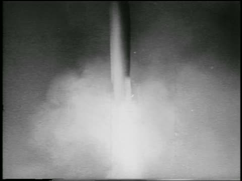 vídeos y material grabado en eventos de stock de b/w nov 3 1957 sputnik 2 rocket blasts off carrying laika the dog first space traveler / newsreel - 1957