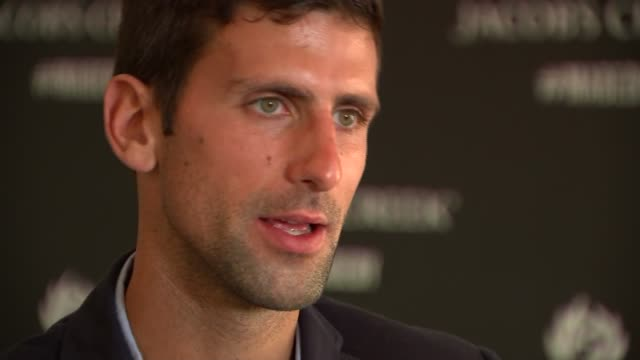 novak djokovic interview ahead of the 2015 wimbledon championships; england: london: all england lawn tennis club: int various of novak djokovic... - gluten free stock videos & royalty-free footage