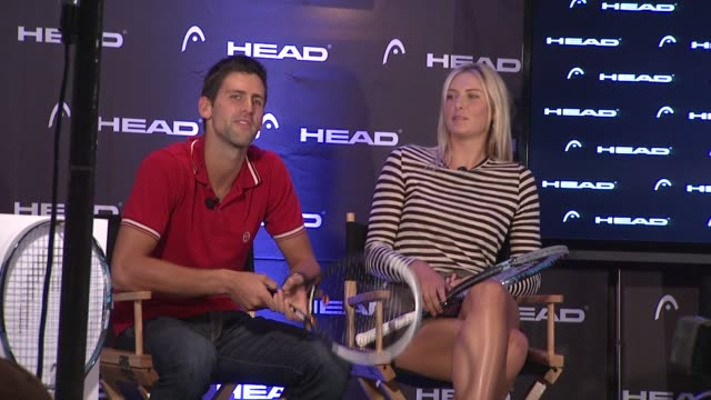vídeos de stock e filmes b-roll de novak djokovic says he played with head racquets early in his career, talks about how hard it is to switch racquets at the maria sharapova and novak... - raqueta