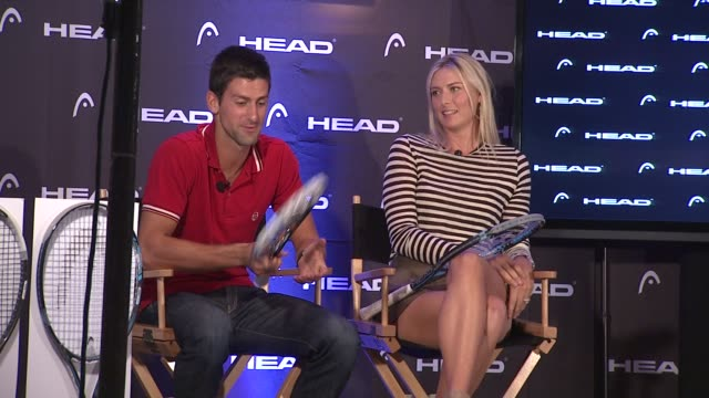vídeos de stock, filmes e b-roll de novak djokovic talks about what he looks at in a racquet and what he likes about this racquet specifically at the maria sharapova and novak djokovic... - maria sharapova