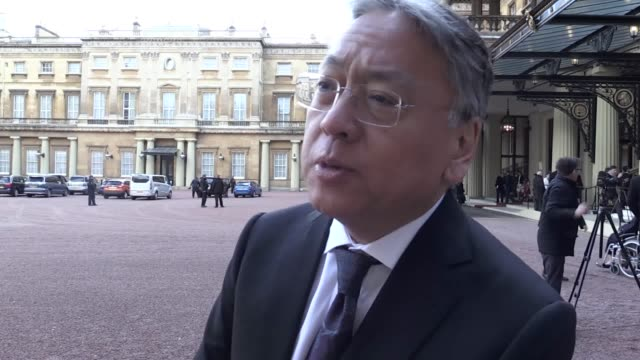 novelist kazuo ishiguro received a knighthood for his services to literature at an investiture ceremony at buckingham palace alongside poet kate... - kazuo ishiguro stock videos & royalty-free footage