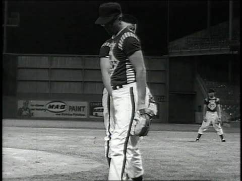 Novelty four man expositional baseball team pitcher strikes out opponents while pitching blindfolded / United States