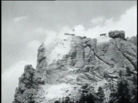 november 09, 1931 montage explosions on mount rushmore reveal the head of george washington / mount rushmore, keystone, south dakota, united states - 1931 stock videos & royalty-free footage