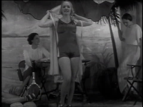 vídeos de stock, filmes e b-roll de november 11, 1935 la woman modeling a swimsuit / chicago, illinois, united states - 1935
