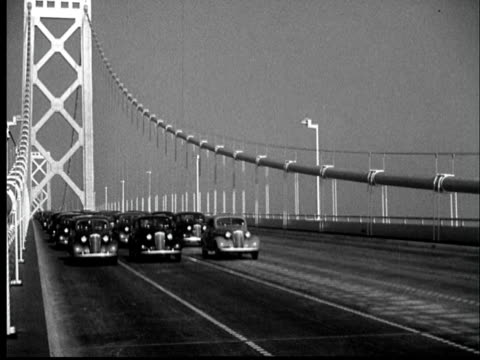 "stockvideo's en b-roll-footage met ""november 12, 1936 ws first cars cross the newly-opened bay bridge/ san francisco, ca/ audio"" - 1936"