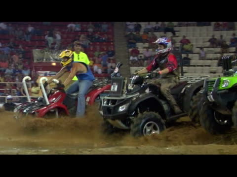 november 14 2006 montage a group of all terrain vehicle riders competing in a water cross race - quadbike stock videos & royalty-free footage