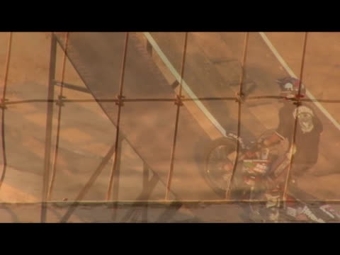 vidéos et rushes de november 14, 2006 montage professional freestyle motocross riders performing a series of extreme jumps off a ramp - format vignette