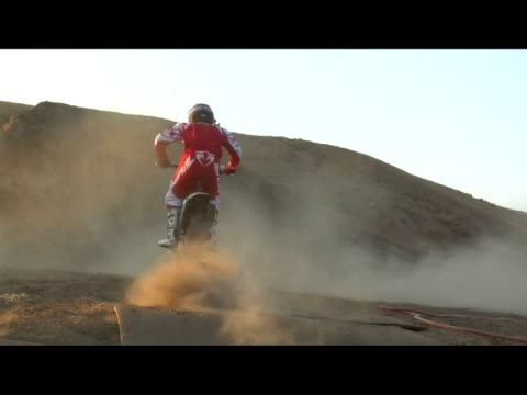 november 14 2006 montage professional freestyle quad and motocross riders performing a series of extreme jumps on a dirt track - quadbike stock videos & royalty-free footage