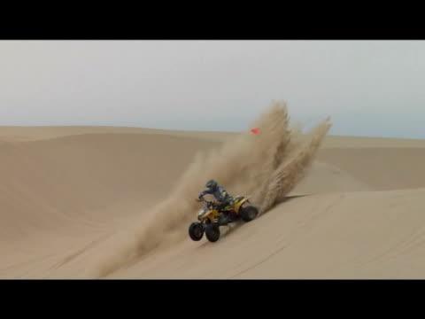 vidéos et rushes de november 14, 2006 montage professional freestyle quad riders carving out a sand dune - format vignette