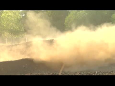 vidéos et rushes de november 14, 2006 montage professional freestyle quadx racers riders riding all terrain vehicles on dirt tracks - format vignette