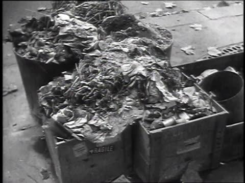 vidéos et rushes de november 17, 1947 montage garbage filling the streets / paris, france - grève