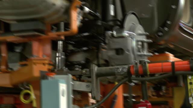 november 18 2008 pan employee working in auto plant / lansing michigan united states - lansing stock videos and b-roll footage