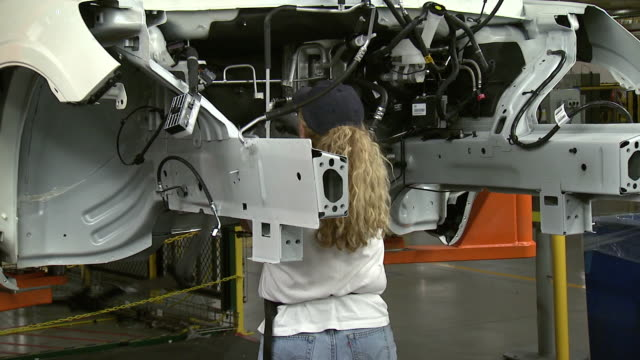 november 19 2008 zo auto assembly worker installing electrical wiring in an automobile on the assembly line / lansing michigan united states - lansing stock videos & royalty-free footage