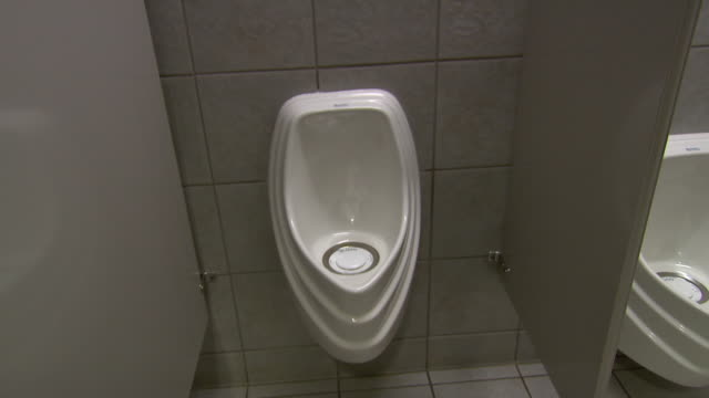 november 19 2008 zo ceramic urinal in a bathroom stall / lansing michigan united states - lansing stock videos and b-roll footage