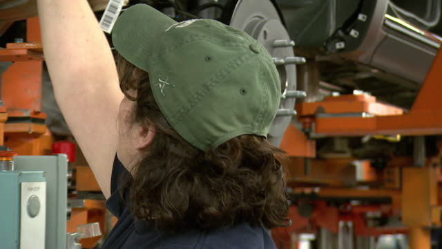 november 19 2008 ms employee working on assembly line / lansing michigan united states - lansing stock videos and b-roll footage