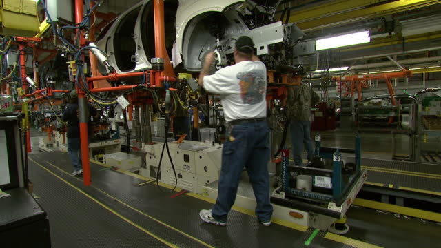 november 19, 2008 employees working on assembly line / lansing, michigan, united states - general motors stock videos & royalty-free footage