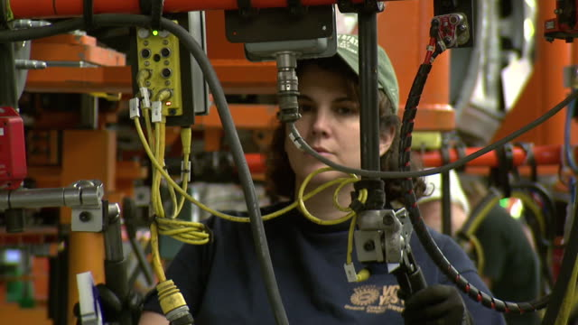 november 19 2008 ms employees working on assembly line / lansing michigan united states - lansing stock videos and b-roll footage