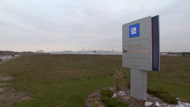 november 19 2008 pan exterior of gm auto plant with sign and logo / lansing michigan united states - general motors stock videos & royalty-free footage