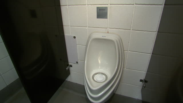 november 19 2008 ws urinal at gm auto plant / lansing michigan united states - lansing stock videos and b-roll footage