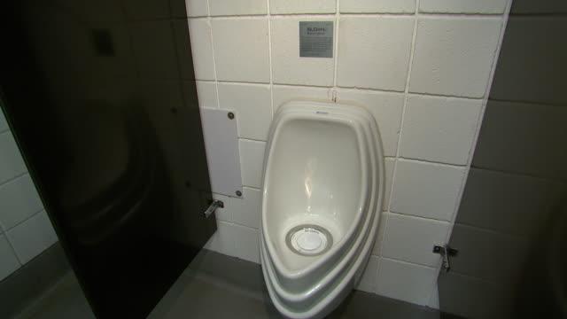 november 19 2008 ws urinal at gm auto plant / lansing michigan united states - lansing stock videos & royalty-free footage
