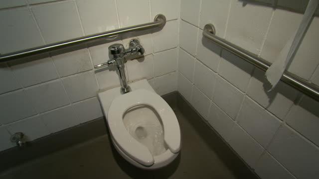 november 19 2008 ha worker flushes toilet / lansing michigan united states - lansing stock videos and b-roll footage
