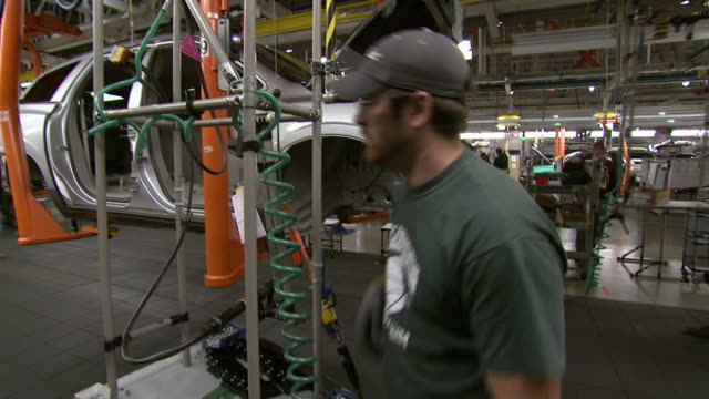november 19 2008 ws worker inspects car on assembly line / lansing michigan united states - lansing stock videos and b-roll footage
