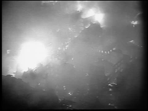 b/w november 1940 high angle wide shot buildings of london burning after german attack / newsreel - burning stock-videos und b-roll-filmmaterial