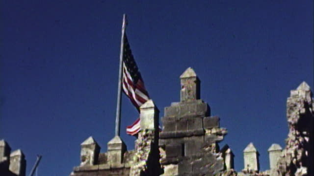 vídeos de stock e filmes b-roll de november 1942 ms an american flag flying atop of the ruins of a french fort after operation torch - 1942