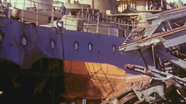 november 1942 td damaged vichy french battleship jean bart run aground in casablanca harbor / morocco - kriegsschiff stock-videos und b-roll-filmmaterial