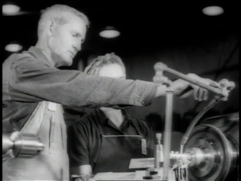 November 1942 LA Machinist instructing woman at metal lathe / Long Beach, California, United States