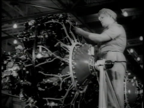 November 1942 LA Mechanic working on aircraft engine / Long Beach, California, United States