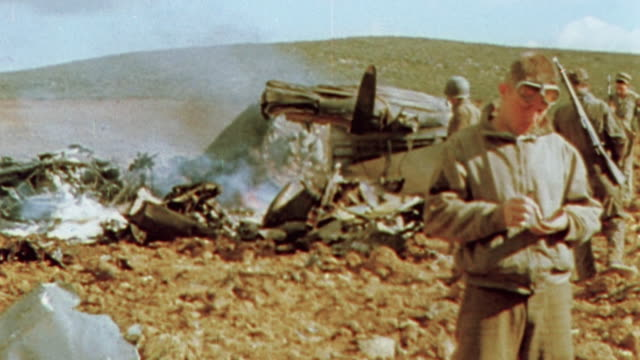 november 1942 montage desert littered with the wreckage of luftwaffe planes as allied soldiers look through the rubble / algeria - luftwaffe stock videos and b-roll footage
